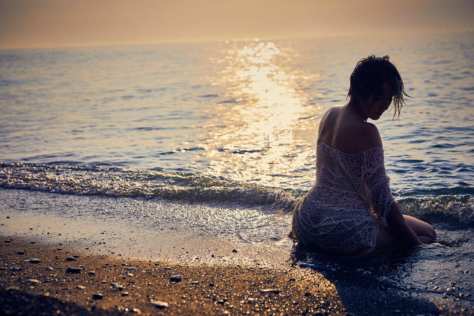 boudoir goddess woman at beach grounding self-care