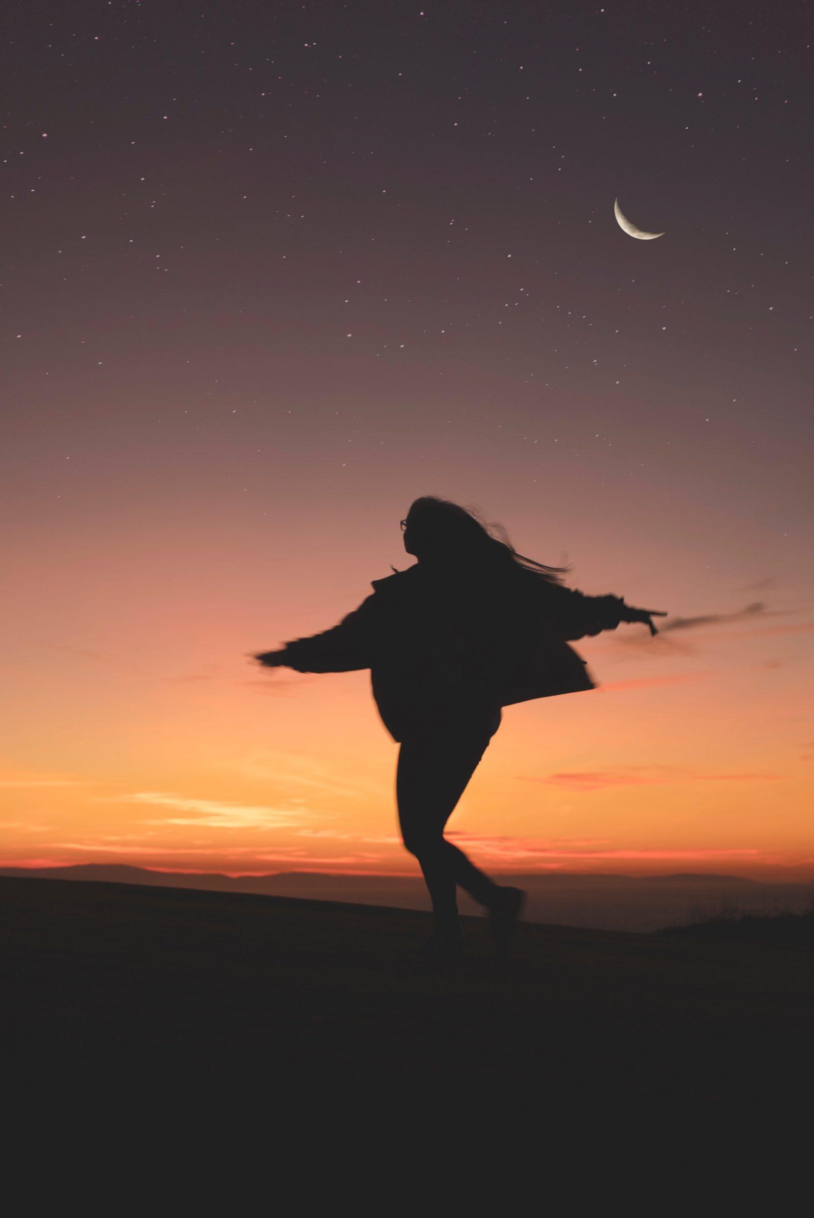 goddess woman dancing under moon self-care